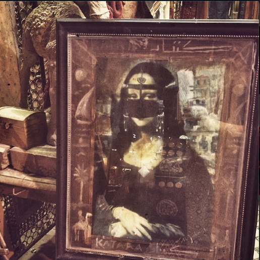 Mona Lisa, Doha Style. Perhaps a bit too much chest on show